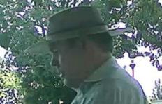 """Surveillance photo of the """"Faux Badge Bandit."""""""