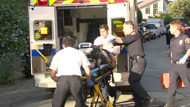 Wounded suspect rushed to ambulance