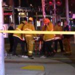 Paramedics move victim to ambulance