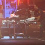 Suspect is wheeled to ambulance