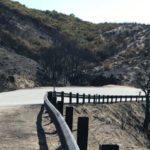 Charred hillsides along Route 75