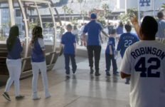 Fans leaving tram car at Dodger Stadium