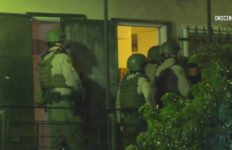 Sheriff's SWAT team members at the apartment