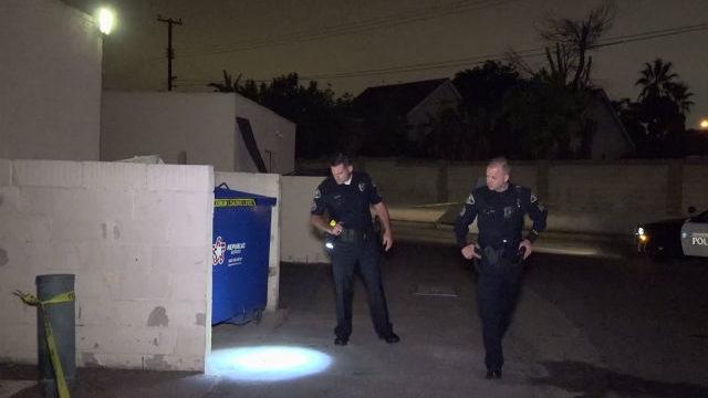 Police search crime scene