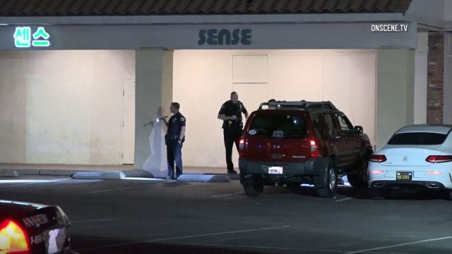 Police search strip mall parking lot