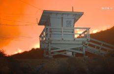 Flames behind a lifeguard tower