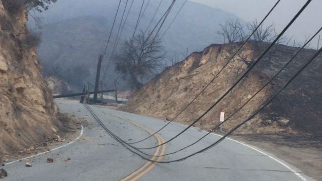 A road blocked by downed power lines