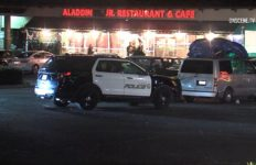 Police officers and vehicles in the restaurant parking lot