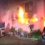 Firefighters battle apartment fire in Garden Grove
