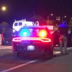 Highway Patrol officers level guns at stopped van