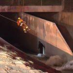 Firefighter rescuing man in Pacoima wash