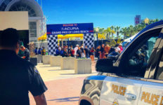 Long Beach police officer outside gate to Grand Prix