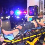 Injured pedestrian lifted into ambulance