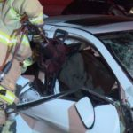 Paramedics work to free trapped victim