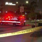 Ambulance at scene of crash in Mid City