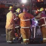 First responders assist a crash victim
