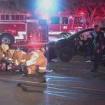 Paramedics assist victim in crash