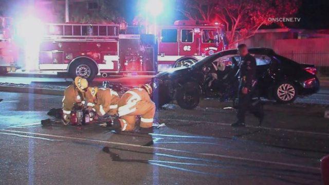 Paramedics assist victim in crash