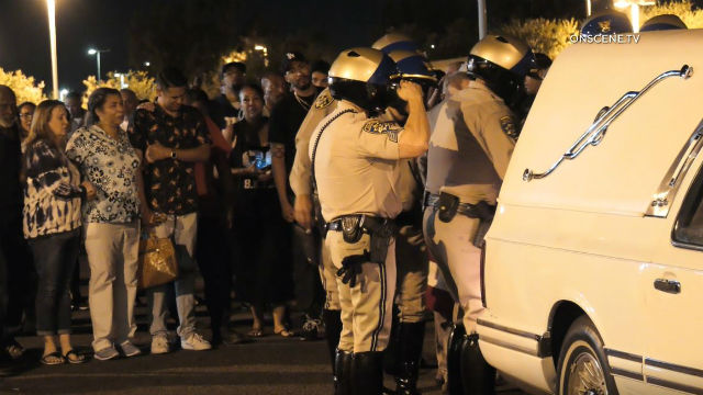 CHP officer salutes his deceased colleague