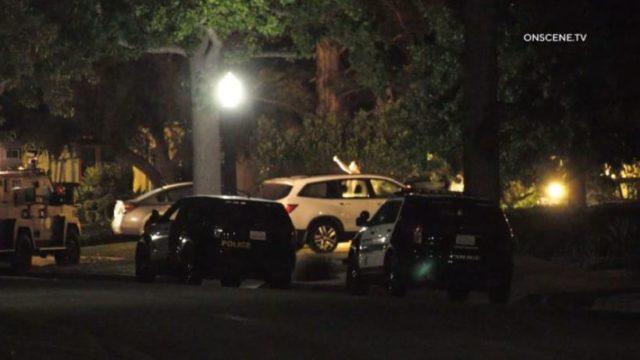 Police vehicles outside San Marino home