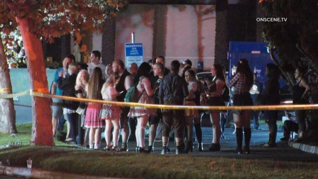 Oktoberfest partiers wait behind police line