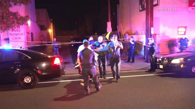 Paramedics assist wounded suspect
