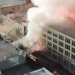Flames from burning warehouse