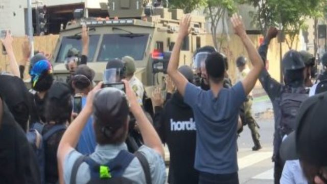 Protesters confront National Guard Vehicle