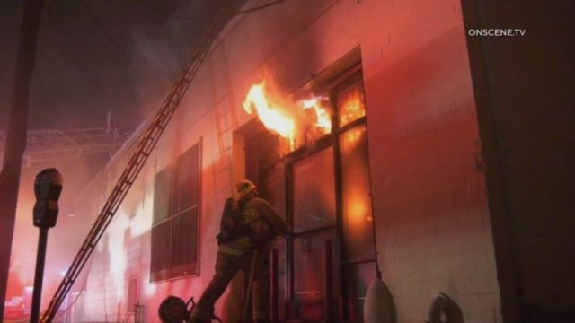 Flames from burning commercial building