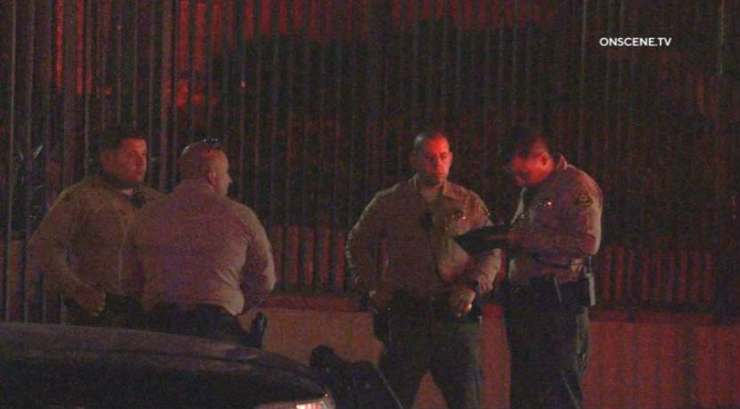 Deputies at the scene of the shooting