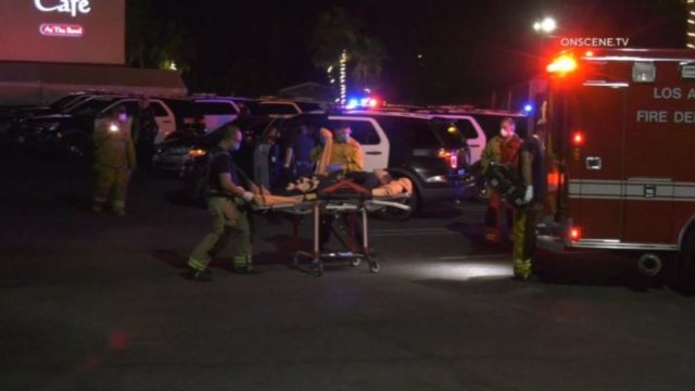 Wounded suspect taken to ambulance
