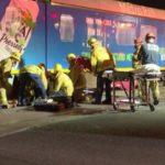 Paramedics assist motorcycle rider